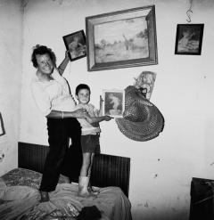 Diamond digger and son standing on bed, Western Transvaal, 1987, Selenium toned silver prints, 40 x 40 cm, Courtesy the artist and Gagosian Gallery